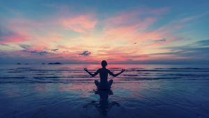 Photo of a person in a yoga position during a sunrise representing how even during quarantine you can get help for eating disorders like anorexia, compulsive eating, binge eating disorder and more through online counseling services in the Washington DC area.