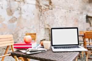 laptop sits on an outdoor table during an online therapy session in Virginia, Maryland, and Washington DC with Monarch Wellness and Psychotherapy