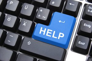 computer keys with the word help on a blue enter key representing the help that can be given through online therapy for eating disorders in Washington DC with Monarch Psychotherapy and Wellness