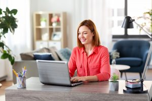 woman logs on to her computer from home for online therapy for eating disorders in Washington DC with monarch wellness and psychotherapy
