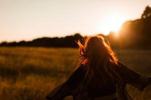 Happy Woman in Field - Trauma Education